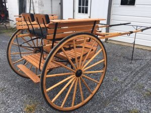 """#470-DRAFT SIZE MEADOWBROOK- 50"""" WHEELS, 86"""" SHAFTS, BLACK CLOTH SEATS, GOOD CONDITION $1050"""