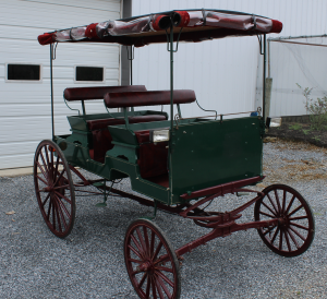 #495 Used Spring Wagon, Cut Under, 2 seats, Hyd Brakes, Lights, Top w/ Fold Down Side, Clear Windows, Pole & Shaft, Good Condition, $2500.