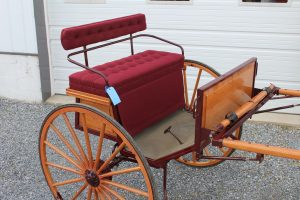 "#506 Horse size Eagletle. Front enter cart. 42"" wheels. 82"" shaft. Hyd. Brakes. Natural finish metal painted maroon with red pin strips. Maroon tufted cushions. Like new. $1850.00"