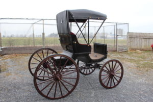 #565 Cut Under Top Buggy Black Body w/Gold Pinstripes Maroon Tufted Cushions Maroon Gear and Wheels With Gold Pinstripes Shaft Good condition Made by A.D. Buggy Shop $3200.00