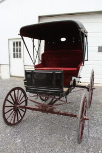 #565 3 Cut Under Top Buggy Black Body w/Gold Pinstripes Maroon Tufted Cushions Maroon Gear and Wheels With Gold Pinstripes Shaft Good condition Made by A.D. Buggy Shop $3200.00