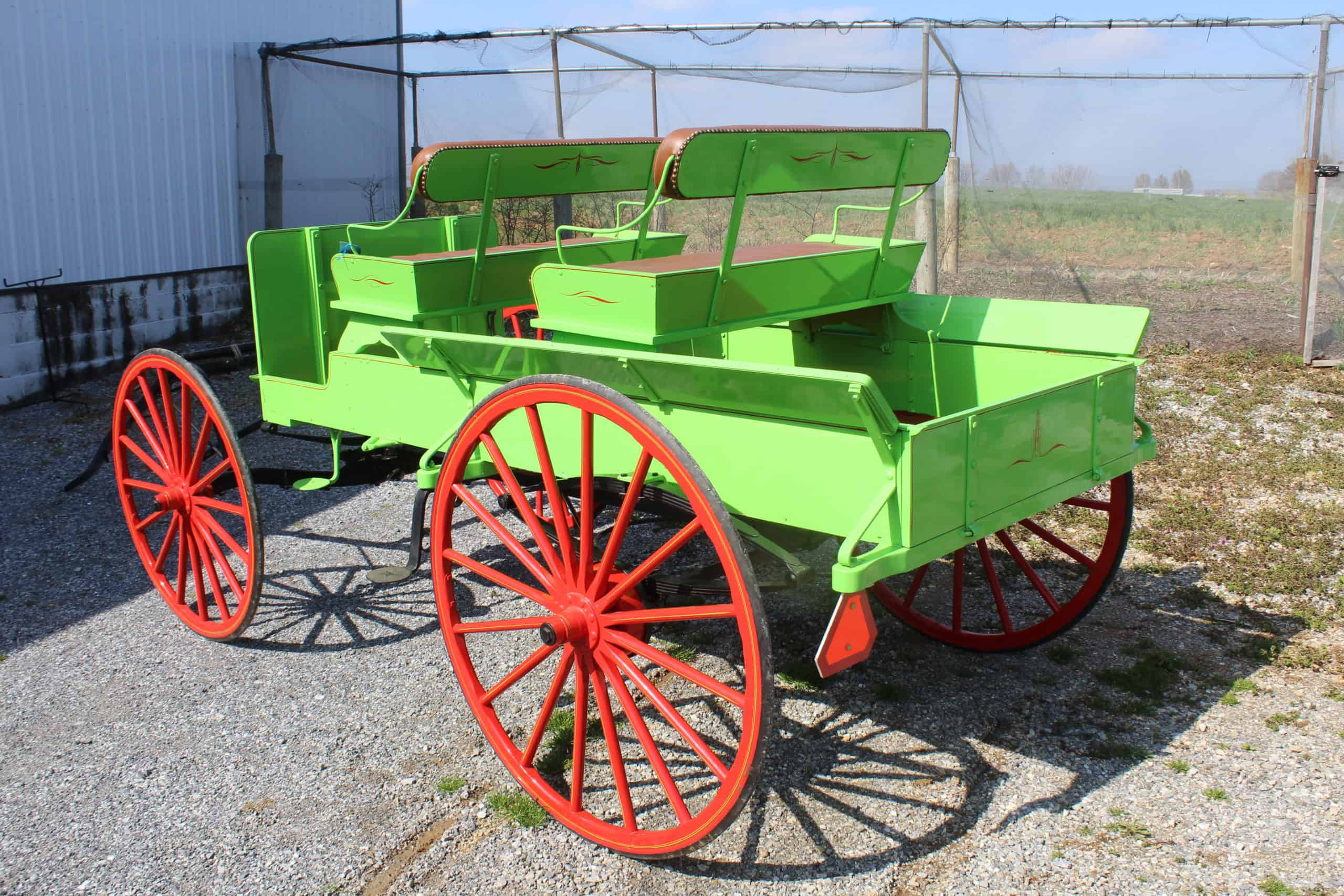 #572 2 Seat Spring Wagon, Like New Condition, Hydaulic brakes, Rubber on Wheels, Body Painted Green, Red Wheels, Black Gear, Red Seat Cushions $3,600.