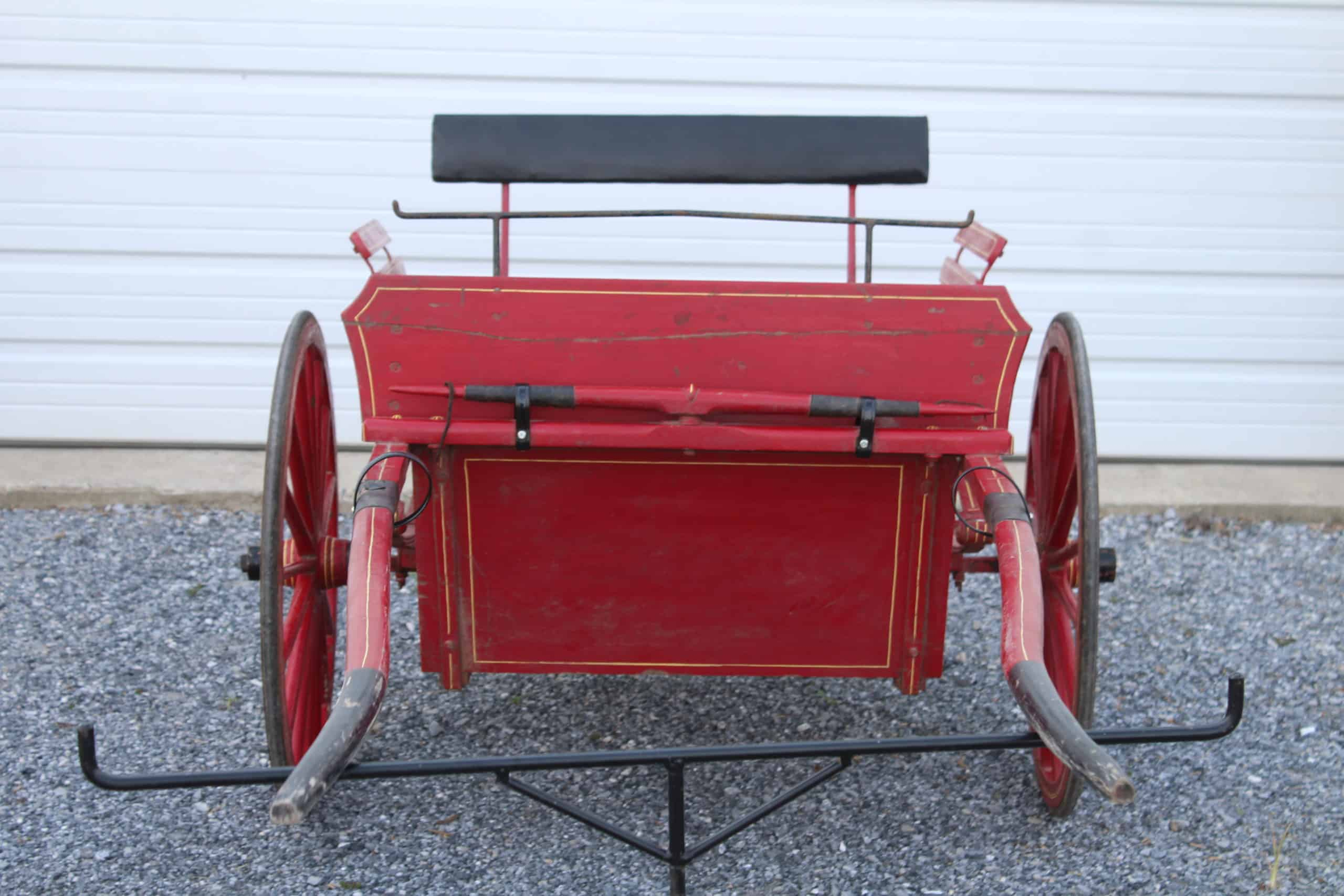 "#598 Used Pony Size Cart, 65"" Shaft, 30"" Wheels on Rubber, Painted Red With Yellow Pin Stripes, Fair Condition, $400.00"