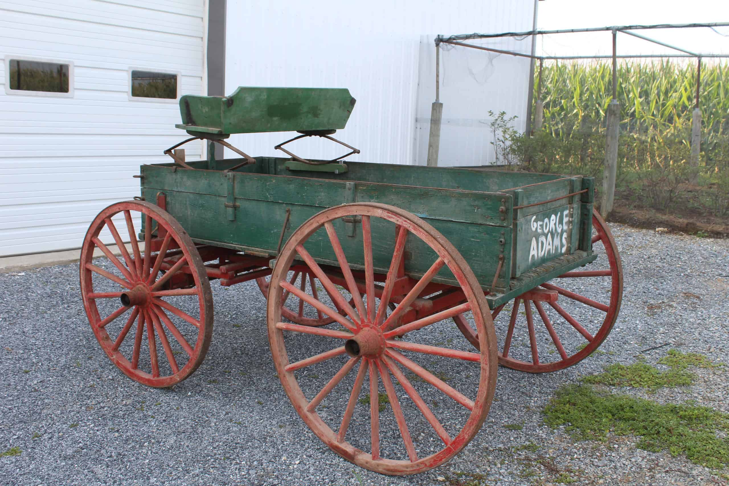 "#601 1-Horse Farm Wagon, Red Wheels, Green Body, Bed Size, 38"" Wide x 7' Long, Spring Seat, Shaft, Good Condition, $1050.00"